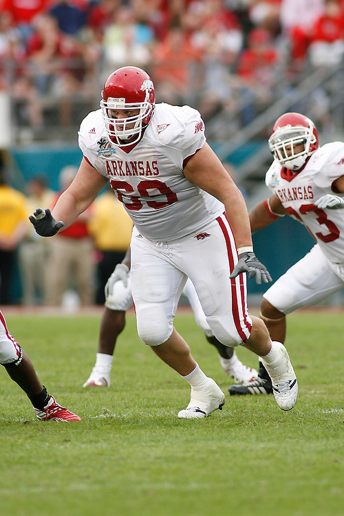 University of Arkansas offensive lineman Zac Tubbs looks to block an opponent during the Wisconsin Badgers 17-14 victory over the Arkansas Razorbacks in the Capital One Bowl at the Florida Citrus Bowl Stadium in Orlando, Florida on January 1, 2007.