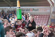 Fans celebrate after Northampton Town secure promotion after the Sky Bet League 2 match between Northampton Town and Bristol Rovers at Sixfields Stadium, Northampton, England on 9 April 2016. Photo by Nigel Cole.