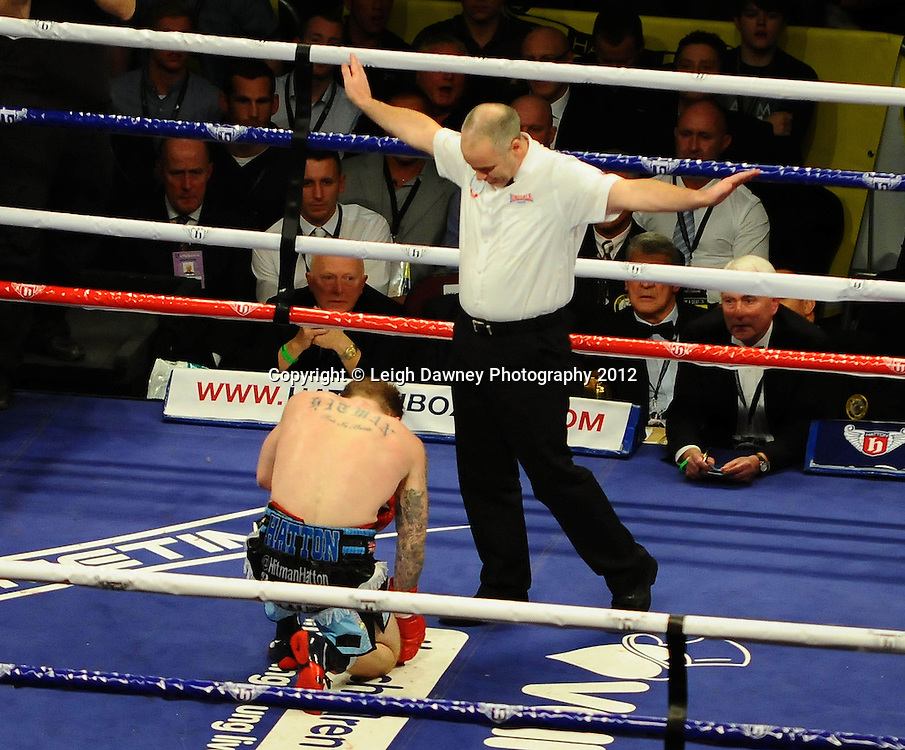 Ricky Hatton gets counted out by the referee after a devastating blow by Vyacheslav Senchenko on the 24th November 2012. Hatton Promotions. Pictures by Photographer Leigh Dawney of © Leigh Dawney Photography 2012.