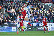 Birmingham City  forward Clayton Donaldson (9) and Huddersfield Town defender Michael Hefele (44)    battle in the air during the EFL Sky Bet Championship match between Huddersfield Town and Birmingham City at the John Smiths Stadium, Huddersfield, England on 5 November 2016. Photo by Simon Davies.