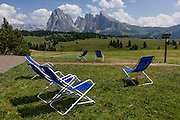 Sunbathing deckchairs for resting hikers on the Siusi plateau, above the South Tyrolean town of Ortisei-Sankt Ulrich in the Dolomites, Italy.