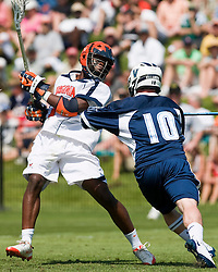 Virginia Cavaliers M  Shamel Bratton  (1) shoots past Villanova Wildcats Defense Eddie DiDonato (10).  The #5 ranked Virginia Cavaliers defeated the #19 ranked Villanova Wildcats 18-6 in the first round of the 2008 NCAA Men's Lacrosse Tournament the University of Virginia's Klockner Stadium in Charlottesville, VA on May 10, 2009.