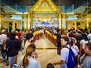 09 NOVEMBER 2018 - BANGKOK, THAILAND: Thais, most in traditional clothing, line up to get into ICONSIAM during the grand opening. ICONSIAM opened November 9. ICONSIAM is a mixed-use development on the Thonburi side of the Chao Phraya River. It includes two large malls, with more than 520,000 square meters of retail space, an amusement park, two residential towers and a riverside park. It is the first large scale high end development on the Thonburi side of the river and will feature the first Apple Store in Thailand and the first Takashimaya department store in Thailand.    PHOTO BY JACK KURTZ
