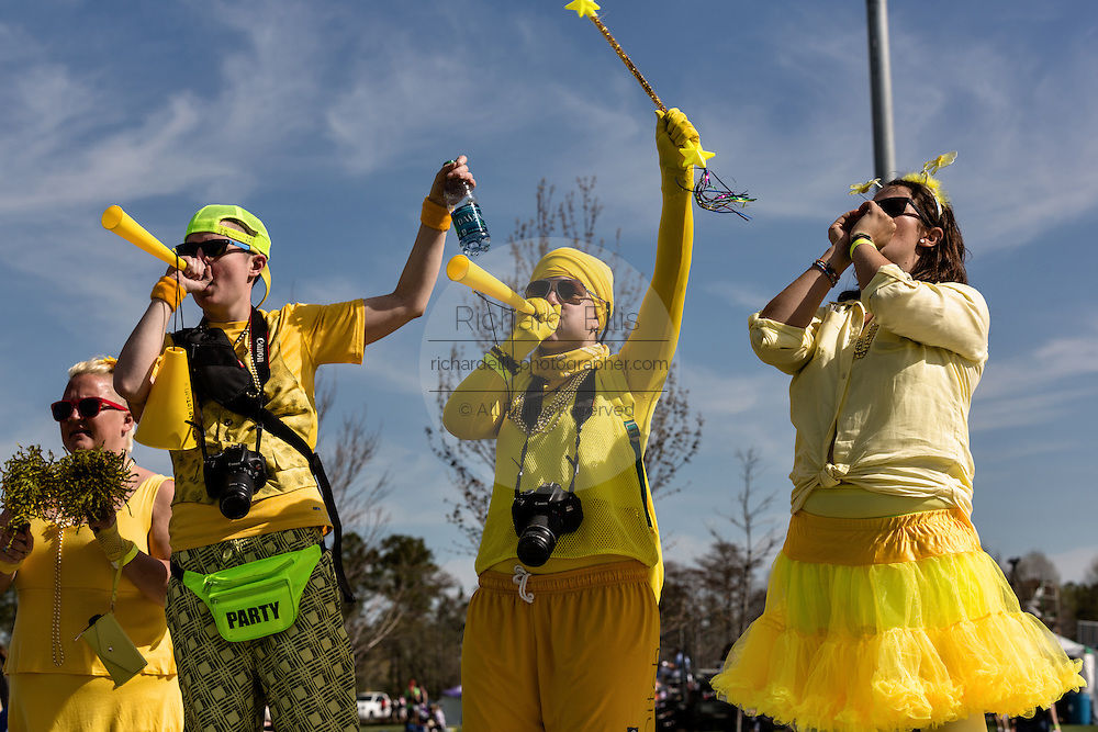 Fans dressed in costume cheer at the 7th Annual Quidditch World Cup April 5, 2014 in Myrtle Beach, South Carolina. The sport, created from the Harry Potter novels is a co-ed contact sport with elements from rugby, basketball, and dodgeball. A quidditch team is made up of seven athletes who play with broomsticks between their legs at all times.