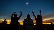 August 21, 2017 - A group of people raise their hands to the total solar eclipse during Global Eclipse Gathering at Big Summit Prairie in the Ochoco National Forest in Oregon. (Photo by: Foster Snell)