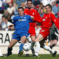 St Johnstone v Falkirk.. 12.04.03<br />John Robertson battles with Craig McPherson<br /><br />Pic by Graeme Hart<br />Copyright Perthshire Picture Agency<br />Tel: 01738 623350 / 07990 594431