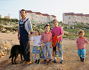 A family poses together in the Gush Etzion area of Israel. Magazine photograph by Debbie Zimelman, Modiin, Israel