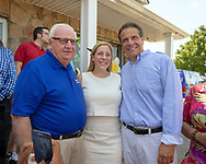 Massapequa, New York, USA. August 5, 2018. L-R, NY Senator JOHN BROOKS; LIUBA GRECHEN SHIRLEY, Congressional candidate for NY 2nd District; and Governor ANDREW CUOMO, running for re-election, pose among supporters during opening of joint campaign office for the 2 Long Islanders, aiming for a Democratic Blue Wave in November midterm elections.