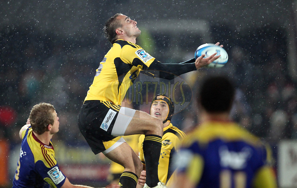 Andre Taylor climbs high to claim the ball..Investec Super Rugby - Highlanders v Hurricanes, 13 May 2011, Rugby Park, Invercargill, New Zealand..Photo: Rob Jefferies / www.photosport.co.nz