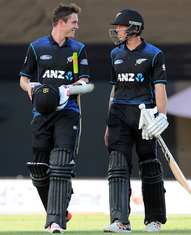 New Zealand's Adam Milne, left and Mitchell Santner leave the field affter defeating Pakistan in the 3rd ODI International Cricket match at Eden Park, Auckland, New Zealand, Sunday, January 31, 2016. Credit:SNPA / Ross Setford