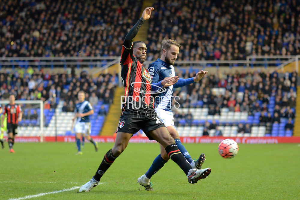 Bournemouth defender Sylvain Distin clears from Birmingham City midfielder Andrew Shinnie during the The FA Cup third round match between Birmingham City and Bournemouth at St Andrews, Birmingham, England on 9 January 2016. Photo by Alan Franklin.