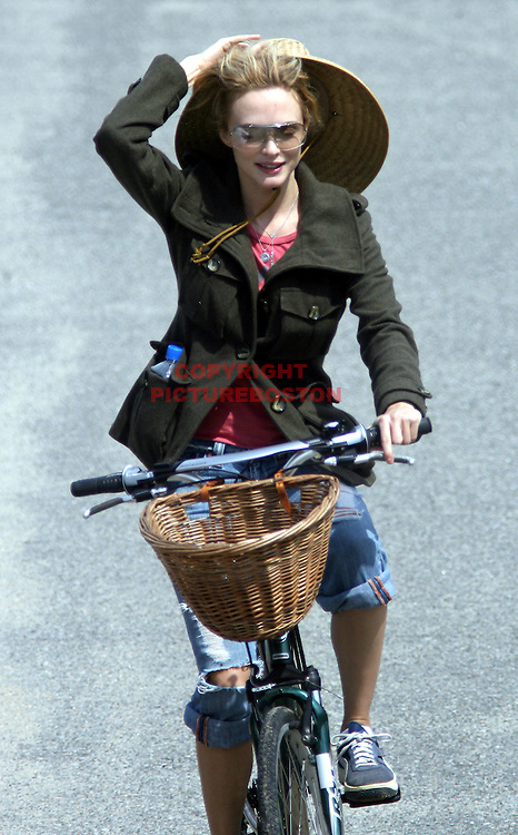 "Star actress Heather Graham almost loses her ""oh so trendy"" straw hat on a bike ride to Sconset, in Nantucket."