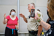 10 JULY 2020 - DES MOINES, IOWA: Polk County Sheriff's Department Captain VANHOOZER argues with members of Black Lives Matter in front of the Polk County Criminal Court. He was telling them to leave the front of the courthouse. About 75 people, members and supporters of Black Lives Matter gathered at the Polk County Courthouse to protest law enforcement harassment of Black Lives Matter. They also showed support for several members of BLM who made their first appearance in court following their arrest at a BLM protest last week. BLM has become very active in Des Moines in the wake of the police killing of George Floyd in Minneapolis in May.      PHOTO BY JACK KURTZ