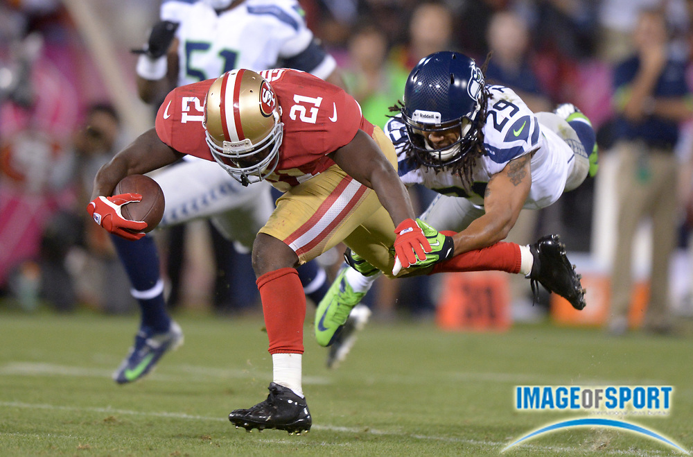 Oct 18, 2012; San Francisco, CA, USA; San Francisco 49ers running back Frank Gore (21) is pursued by Seattle Seahawks safety Earl Thomas (29) at Candlestick Park. The 49ers defeated the Seahawks 13-6.