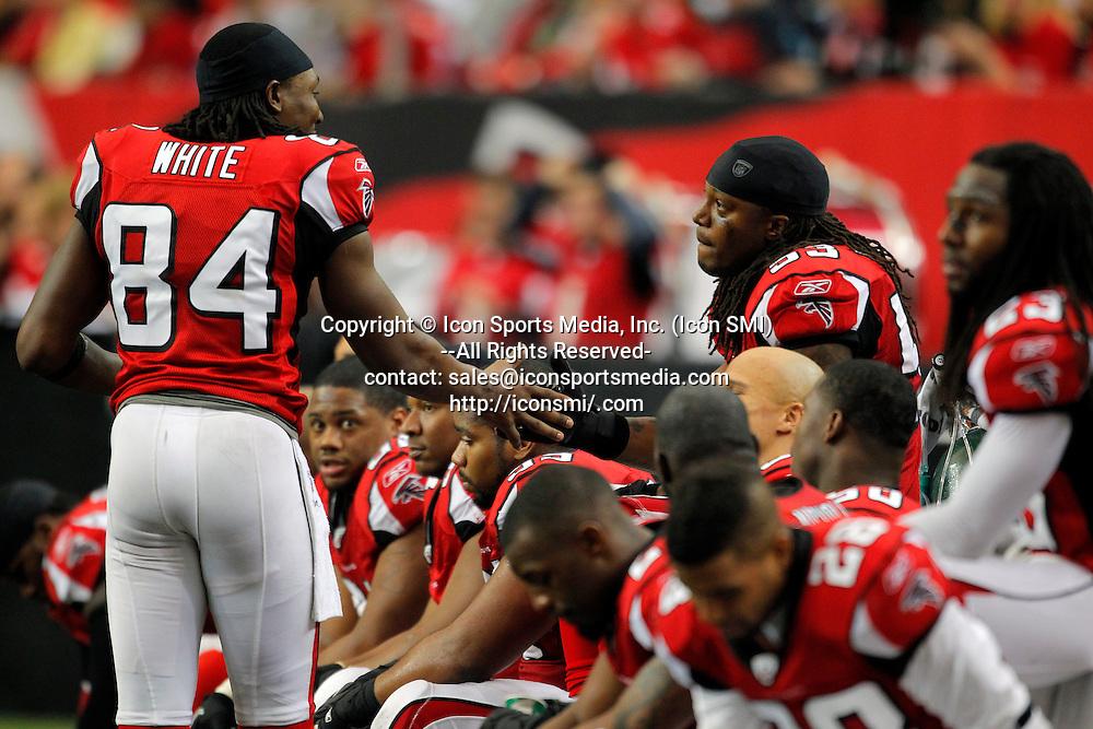 02 January 2011: Atlanta Falcons wide receiver Roddy White (84) congratulates Atlanta Falcons linebacker Mike Peterson (53) on clinching the NFC South in the Atlanta Falcons 31-10 victory over the Carolina Panthers at the Georgia Dome in Atlanta Georgia.