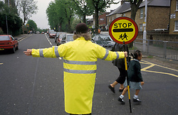 School crossing patrol outside primary school, UK