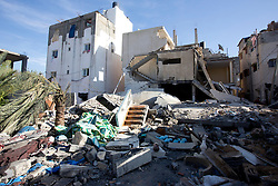 © Licensed to London News Pictures 29/11/2012.  Rafah refugee camp, Gaza. Eight days after the Israeli missile strikes a family home still lies in rubble.  This building was a complex of three houses with separate families.  Fortunately no one was injured or killed as the Israeli Defence Force (IDF) fired a warning bomb into the area prior to the strike.  The warning bomb is a loud sound that alerts the local people that an air strike is imminent.  This is the second time that this building has been hit, the first time being in 2008.  The family had just managed to re build it before it was destroyed.   Photo credit : Alison Baskerville/LNP