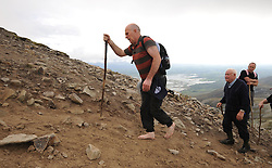 Barefoot Pilgrim Thomas Stokes from Longford on his way to the summit of Croagh Patrick during the Annual pilgrimage yesterday.<br /> Pic Conor McKeown