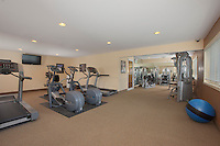 McDonogh Township Apartments interior image of fitness center by Jeffrey Sauers of Commercial Photographics