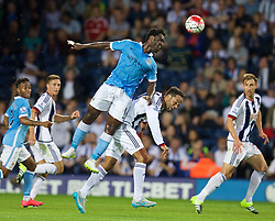 WEST BROMWICH, ENGLAND - Monday, August 10, 2015: Manchester City's Wilfried Bony in action against West Bromwich Albion's Joleon Lescott during the Premier League match at the Hawthorns. (Pic by David Rawcliffe/Propaganda)