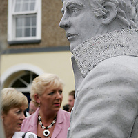 Poet Brian Merriman watches over as a crowd came to Ennistymon on Wednesday evening to see his statue unveiled.<br /> <br /> Photograph by Yvonne Vaughan.