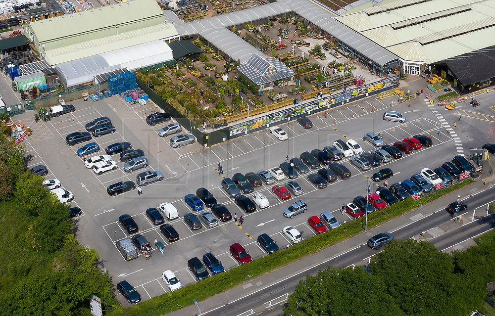 © Licensed to London News Pictures. 16/05/2020. Chessington, UK. Cars fill the carpark at Chessington Garden Centre in Surrey after opening fully this week for the first time since March 24th. Online orders were available for collection during the latter part of lockdown. The government has announced a series of measures to slowly ease lockdown, which was introduced to fight the spread of the COVID-19 strain of the coronavirus. Photo credit: Peter Macdiarmid/LNP