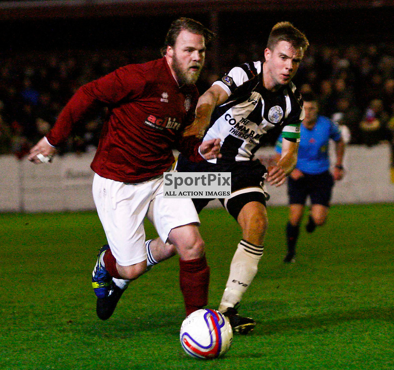 Linlithgow midfielder Graham Weir gets away from Wick captain Alan Farquhar during tonights William Hill Scottish cup match at Prestonfield Linlithgow
