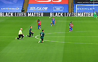Football - 2019 / 2020 Premier League - Crystal Palace vs Burnley<br /> <br /> Players of both teams go down on one knee before kick off, at Selhurst Park<br /> <br /> COLORSPORT/ANDREW COWIE