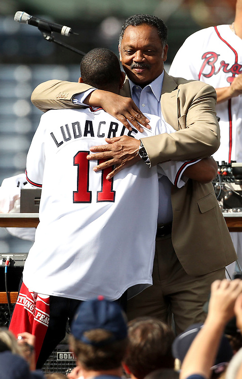 ATLANTA, GA - MAY 14:  Reverend Jesse Jackson (right) embraces singer Ludacris during a post-game concert by Ludacris after the game between the Atlanta Braves and the Philadelphia Phillies at Turner Field on May 14, 2011 in Atlanta, Georgia.  (Photo by Mike Zarrilli/Getty Images)