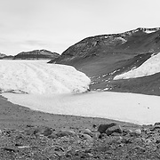 Lake Bonney and Taylor Glacier. This is the glacier which Scott descended to discover this Dry Valley in 1903, later named Taylor Valley after geologist Griffith Taylor. Rhone Glacier on right.