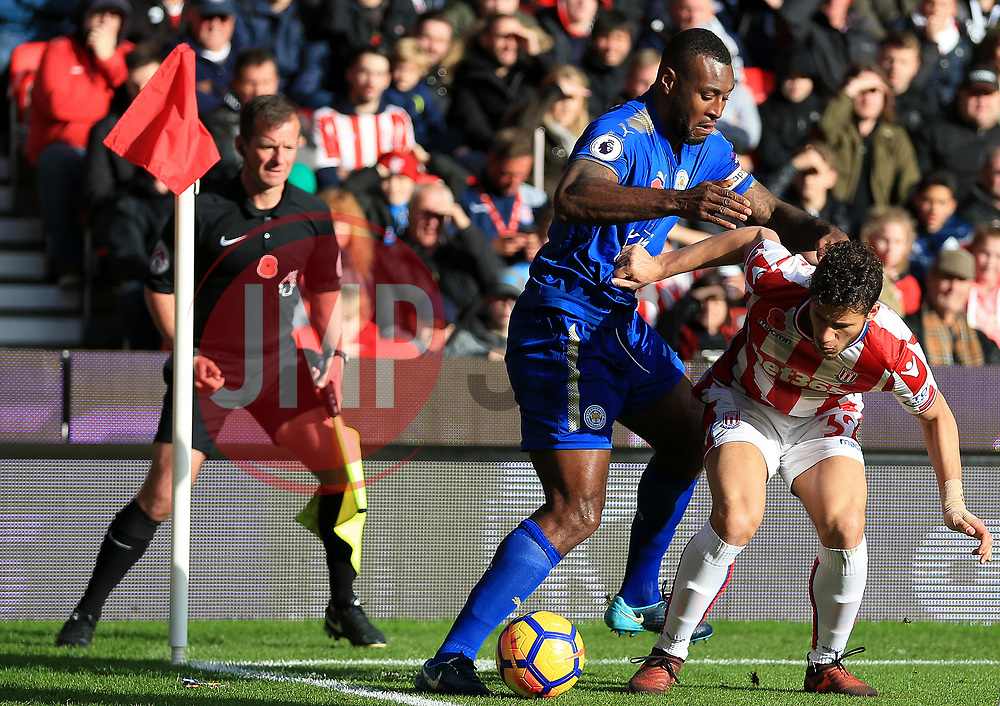 Wes Morgan of Leicester City battles for the ball with Ramadan Sobhi of Stoke City - Mandatory by-line: Paul Roberts/JMP - 04/11/2017 - FOOTBALL - Bet365 Stadium - Stoke-on-Trent, England - Stoke City v Leicester City - Premier League