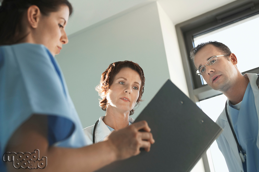 Physicians Reviewing Medical Chart low angle view