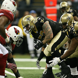 2007 December, 16: New Orleans Saints center Jeff Faine (52) during a 31-24 win by the New Orleans Saints over the Arizona Cardinals at the Louisiana Superdome in New Orleans, LA.