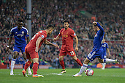 Eden Hazard (Chelsea) shoots and scores Chelsea's opening goal, 1-0 during the Barclays Premier League match between Liverpool and Chelsea at Anfield, Liverpool, England on 11 May 2016. Photo by Mark P Doherty.