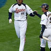 22 March 2009: #41 Atsunori Inaba of Japan celebrates with #8 Akinori Iwamura after scoring during the 2009 World Baseball Classic semifinal game at Dodger Stadium in Los Angeles, California, USA. Japan wins 9-4 over Team USA.