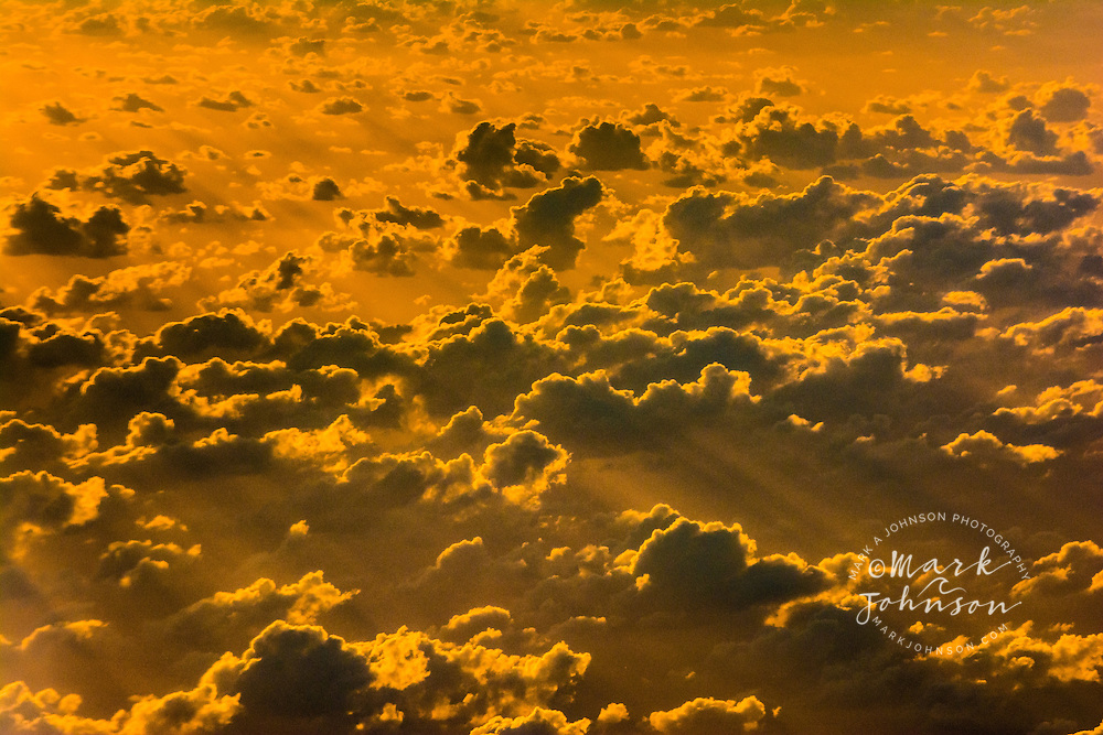 Aerial of clouds over the Pacific Ocean at sunset