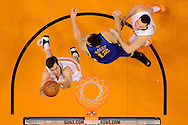 Dec 15, 2013; Phoenix, AZ, USA; Phoenix Suns guard Goran Dragic (1) puts up a shot as teammate forward Miles Plumlee (22) defends Golden State Warriors center Andrew Bogut (12) in the second half at US Airways Center.  The Suns defeated the Warriors 106-102. Mandatory Credit: Jennifer Stewart-USA TODAY Sports