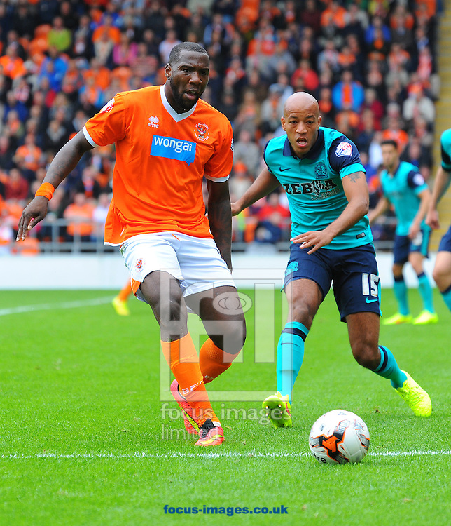 Ishmael Miller of Blackpool (left) battles with Alex Baptiste of Blackburn Rovers during the Sky Bet Championship match at Bloomfield Road, Blackpool<br /> Picture by Greg Kwasnik/Focus Images Ltd +44 7902 021456<br /> 16/08/2014