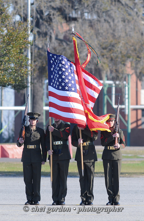 Marine Corps color guard presents the American and Marine Corps flags during a graduation ceremony at the Marine Corps Recruit Depot (MCRD) in Parris Island, SC on Friday, March 15, 2013.