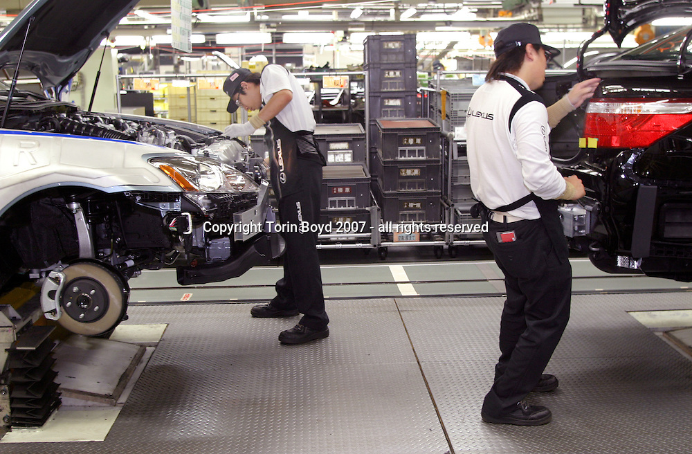 This is the assembly line of Toyota Motor Corporation's Tahara plant located in Aichi Prefecture where Toyota manufactures its luxury Lexus sedans. This includes the Lexus models: LS600h (hybrid launched in Japan in May 2007), the 600hl, LS460, 460L, GS450h, 430, 350, 300, IS350 and 250. On average there are 670 vehicles manufactured here every day, which is about one car every 83 seconds coming off the line. Also unique to this plant is the rigid quality control standards that checks for scratches, imperfections, noise levels in the cab, and an extra inspection for blemishes on 36 spots using a hand held digital measuring device that takes 15 to 20 minutes for each car.