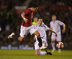 Manchester, England - Tuesday, March 13, 2007: Manchester United's Kieran Richardson tackles Europe XI's Robbie 'God' Fowler during the UEFA Celebration Match at Old Trafford. (Pic by David Rawcliffe/Propaganda)