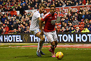Nottingham Forest forward Britt Assombalonga (9) holds off Aston Villa defender Nathan Baker (2) during the EFL Sky Bet Championship match between Nottingham Forest and Aston Villa at the City Ground, Nottingham, England on 4 February 2017. Photo by Jon Hobley.