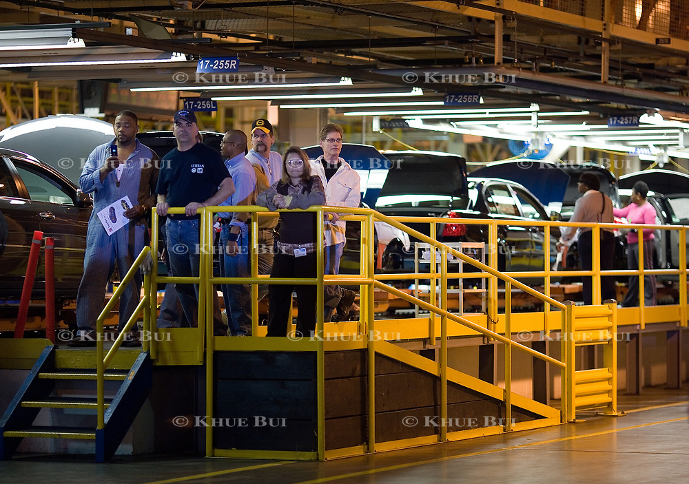 Workers look on as President Bush tours the General Motors Fairfax Assembly Plant Tuesday, March 20, 2007, in Fairfax, KS.  Tour guides are Gary Cowger, Group Vice-President of Manufacturing and Labor; Paul Marr, Plant Manager; Jeff Manning, President of UAW Local 31.  <br /> <br /> Photo by Khue Bui