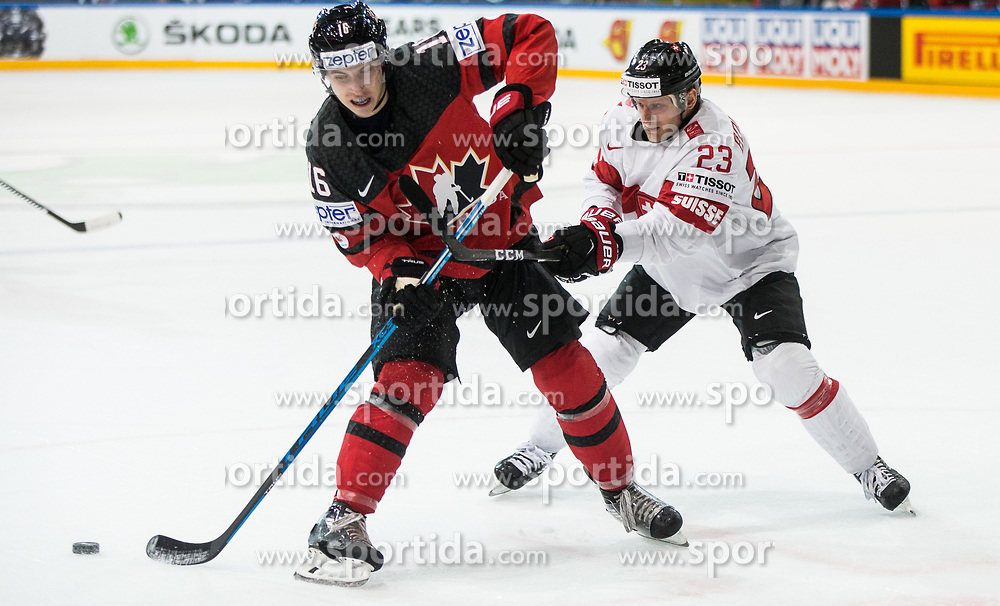 Mitch Marner of Canada vs Simon Bodenmann of Switzerland during the 2017 IIHF Men's World Championship group B Ice hockey match between National Teams of Canada and Switzerland, on May 13, 2017 in AccorHotels Arena in Paris, France. Photo by Vid Ponikvar / Sportida