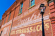 Historic advertisement on red brick building, Jacksonville, Oregon USA