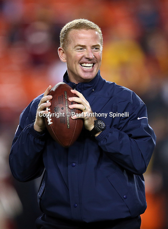 Dallas Cowboys head coach Jason Garrett smiles as he plays catch before pregame warmups at the 2015 week 13 regular season NFL football game against the Washington Redskins on Monday, Dec. 7, 2015 in Landover, Md. The Cowboys won the game 19-16. (©Paul Anthony Spinelli)