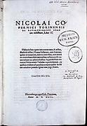 Nicolas Copernicus (1473-1543) Polish astronomer. Title page of his 'De revolutionibus orbium coelestium' Nuremberg 1543 which contained his heliocentric (sun-centred) theory of the universe.