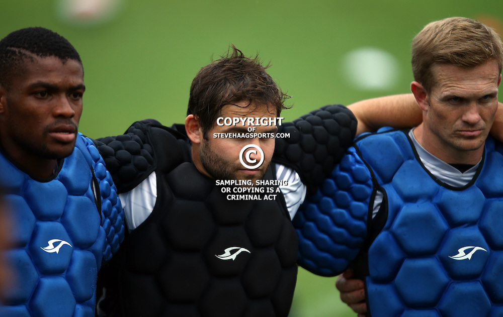 DURBAN, SOUTH AFRICA, 8 ,MARCH, 2016 - Sibusiso Sithole with Cobus Reinach and Michael Claassens during The Cell C Sharks training session  at Growthpoint Kings Park in Durban, South Africa. (Photo by Steve Haag)<br /> <br /> images for social media must have consent from Steve Haag