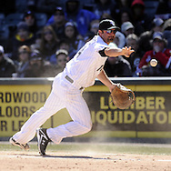 CHICAGO - APRIL 03:  Paul Konerko #14 the Chicago White Sox tosses the ball to Jake Peavy during the game against the Kansas City Royals on April 3, 2013 at U.S. Cellular Field in Chicago, Illinois.  The White Sox defeated the Royals 5-2.  Ramirez was charged with an error on the play.(Photo by Ron Vesely)   Subject: Paul Konerko; Jake Peavy