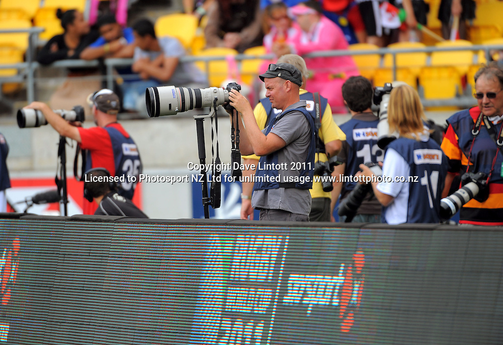 Photographer Chris Skelton (Dominion Post) reviews his images. IRB Wellington Sevens - Day One at Westpac Stadium, Wellington, New Zealand on Friday, 4 February 2011. Photo: Dave Lintott / photosport.co.nz